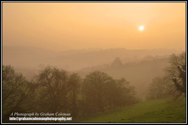Misty sunset on the Lansdown hills on the Cotswold escarpment near Bath, a photograph from Graham Coleman's Landscapes of the Cotswolds.