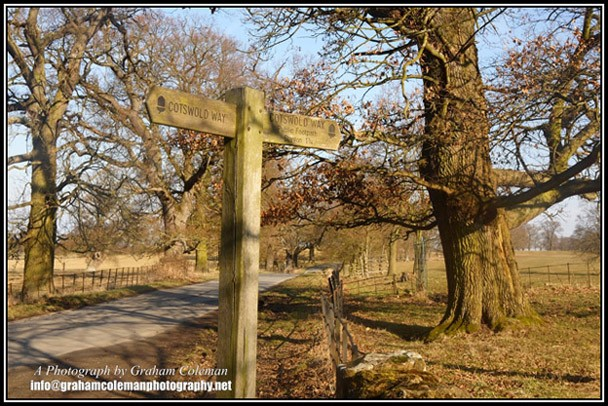 The Cotswold way at Stanway, view of cotswold way sign post and a country lane through the estate, pictures of the Cotswolds by Graham Coleman.