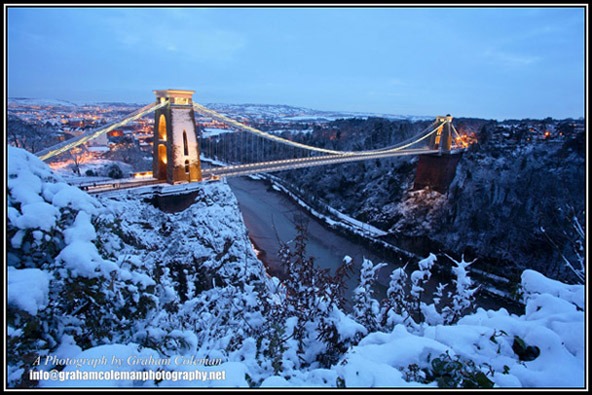 view of the clifton suspension bridge at twilight in the snow